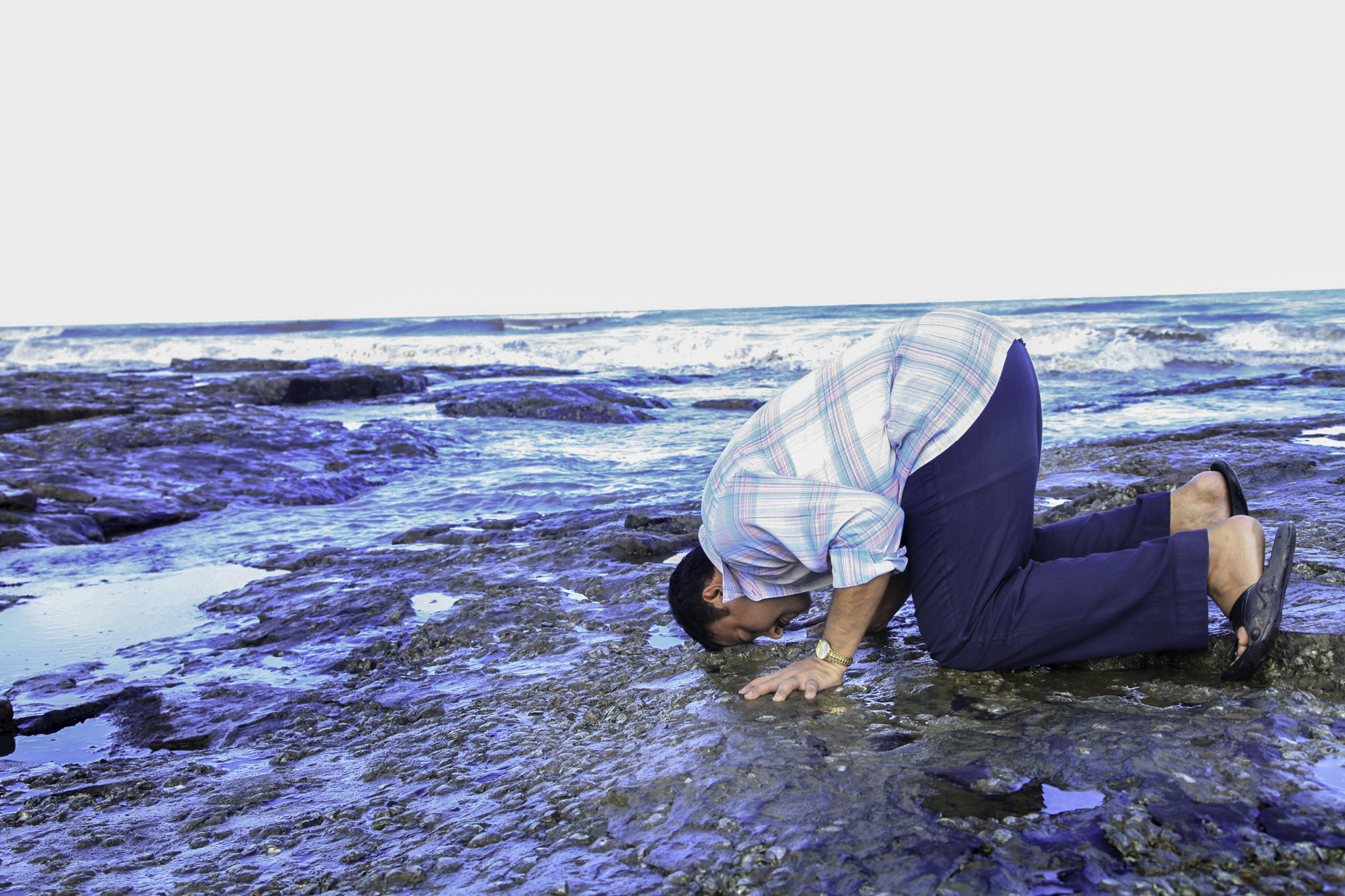Person offering prostration in respect of the ocean