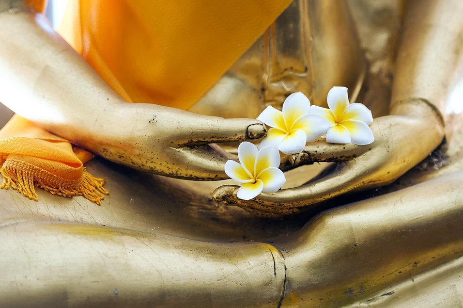 Buddha stucco with flower.jpg