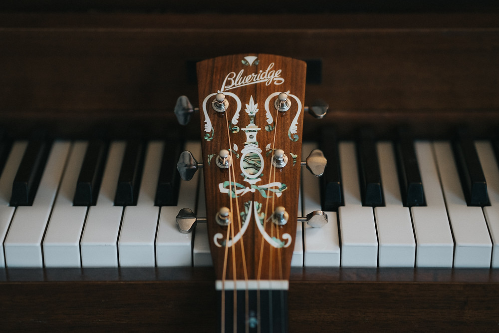 Guitar Headstock On Piano Keyboard