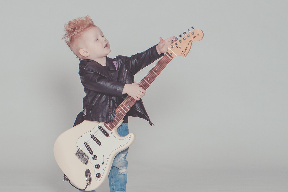 Boy In Leather Jacket With Guitar