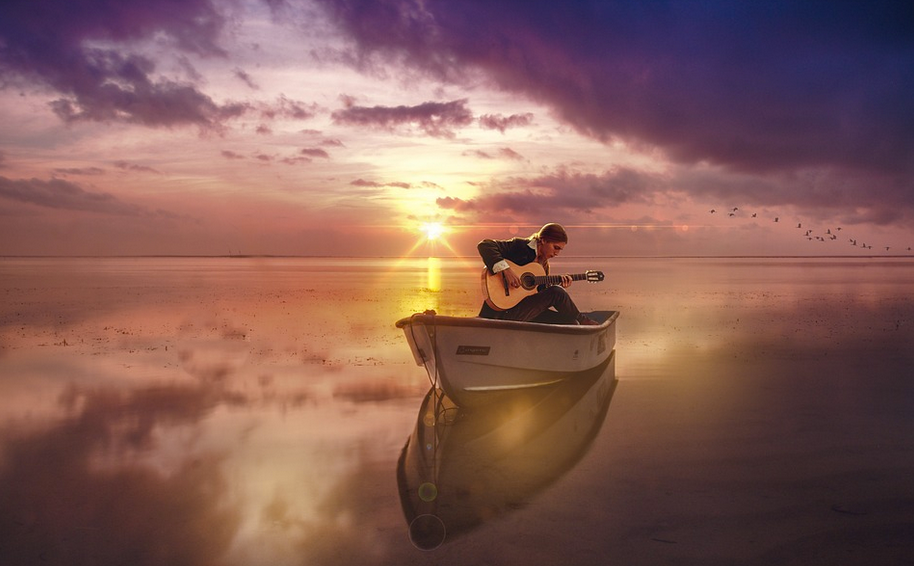 Guitarist in boat