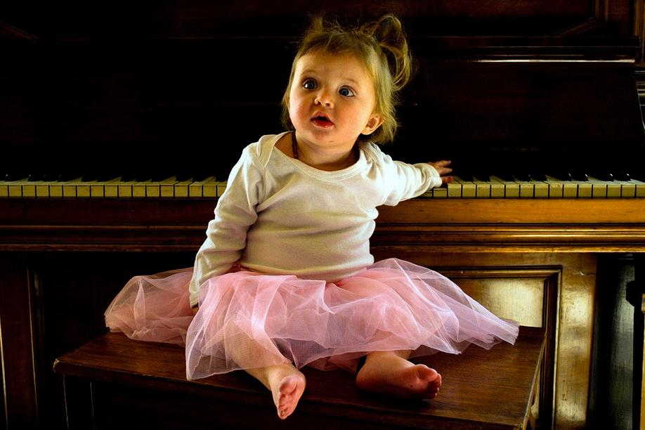 Girl in tutu playing piano