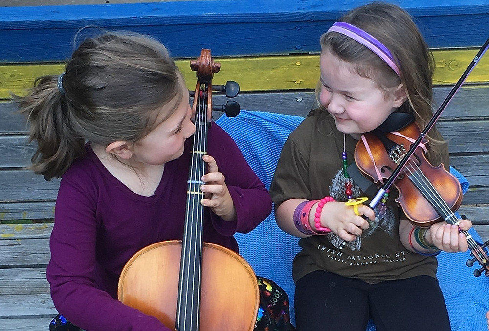 children playing cello and violin