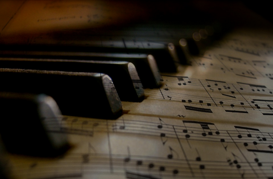 Sheet music superimposed on piano keys