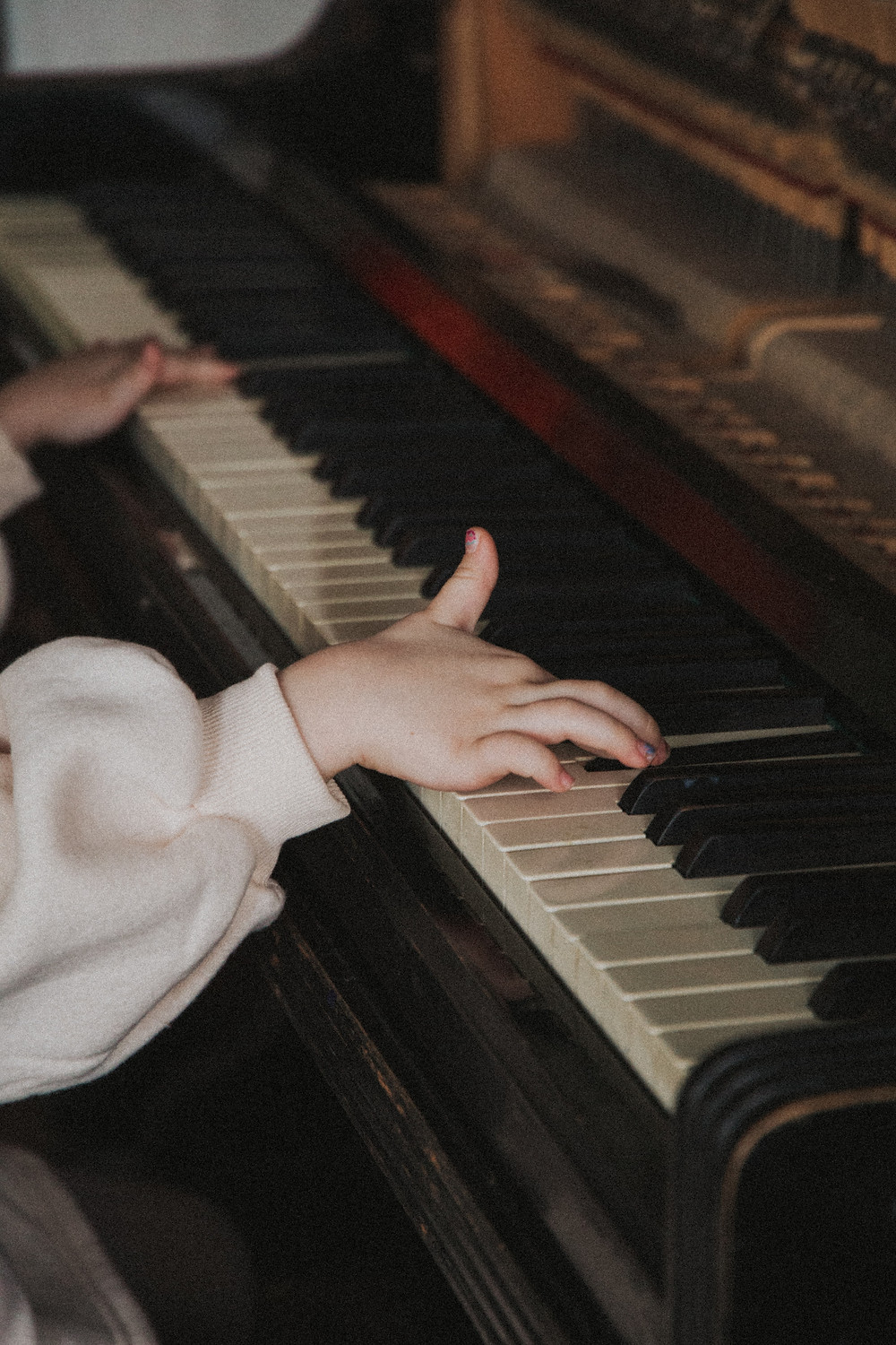 young piano player's hands