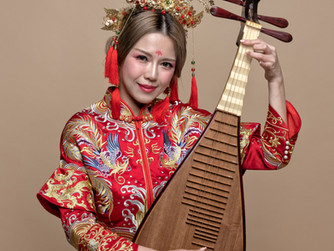 Musician Wen Learns To Play The Lute
