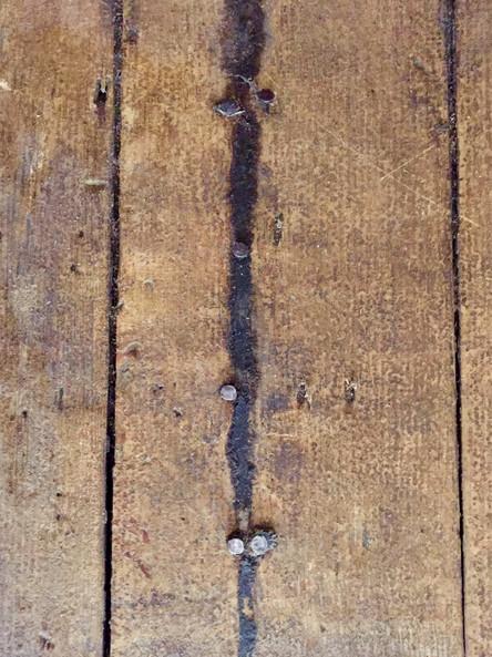 Floor tacks in front of bottom step of G
