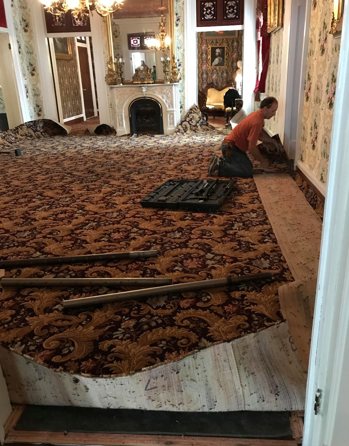 Carpet being stretched to reach the tack strip.