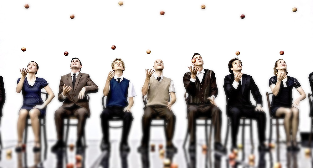 Project managers juggling tasks