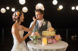 bride and groom paiko cake cutting 8:12:14.jpg
