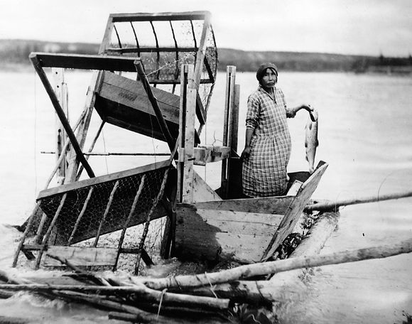 woman at fish wheel
