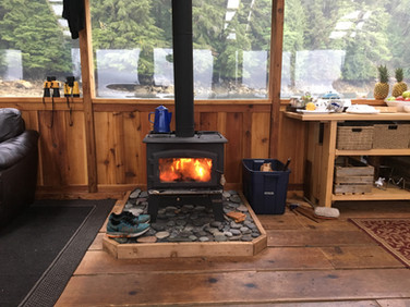 Woodstove in the dining room at Khutzeymateen Wilderness Lodge.