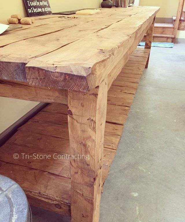 Each board was hand hued and distressed on this customers custom work bench.jpg