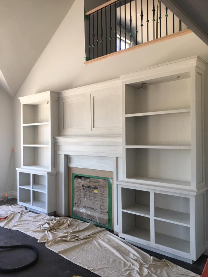 Fireplace mantel and bookcase