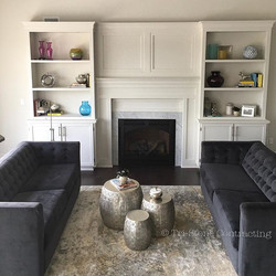We designed, and then built this fireplace surround and the bookshelves in our shop._.jpg