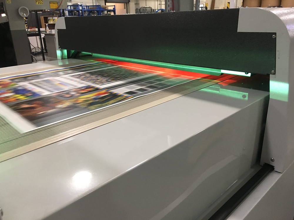 H&B ExcelCoar ZR30 coating printed sheets at Allen Press in Lawrence, Kansas