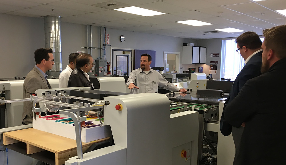 H&B Vice President of Operations Jim Riga briefly explains the ExcelCoat ZRS design features and answers technical questions before a demonstration takes place during a March 11-12 Harris & Bruno International open house.