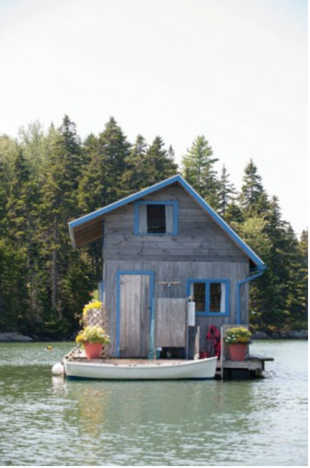 Floating tiny house and dinghy