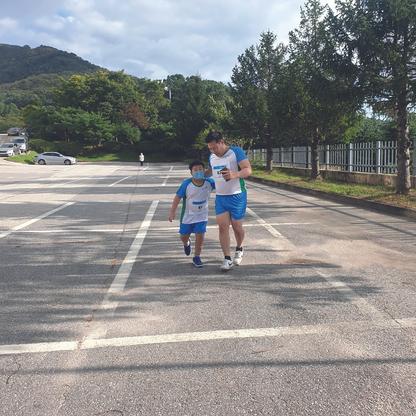 Vater und Sohn, Erbe Roadrunners, Seoul, Korea