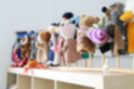 Funny puppets in a kindergarten classroo