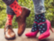 Legs of a young couple in stylish shoes,