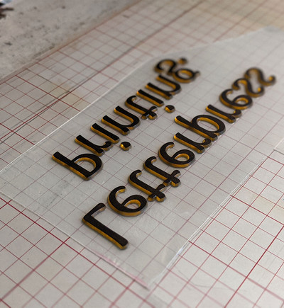 Cutting in preparation for letterpress print.