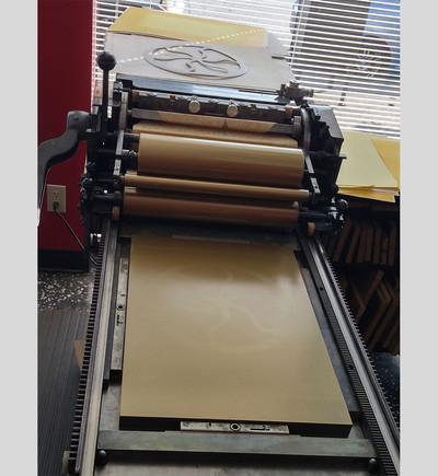 Third pass: pressure print (gold).