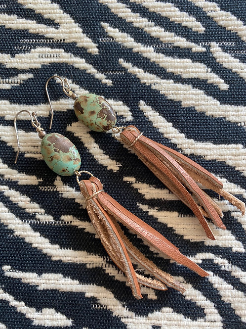 turquoise oval with brown fringe