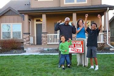 African American family celebrates new home.