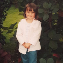 Born with a cleft lip and palate, the image shows Beth at six years old