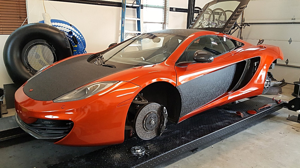 Polishing a Wrapped Mclaren