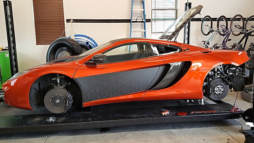 Buffing a Wrap on a Mclaren