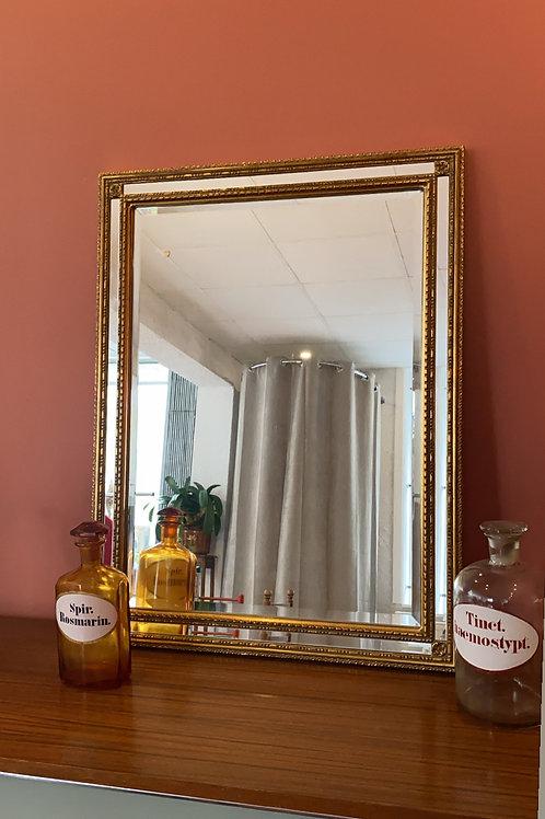 Grand miroir doré biseauté