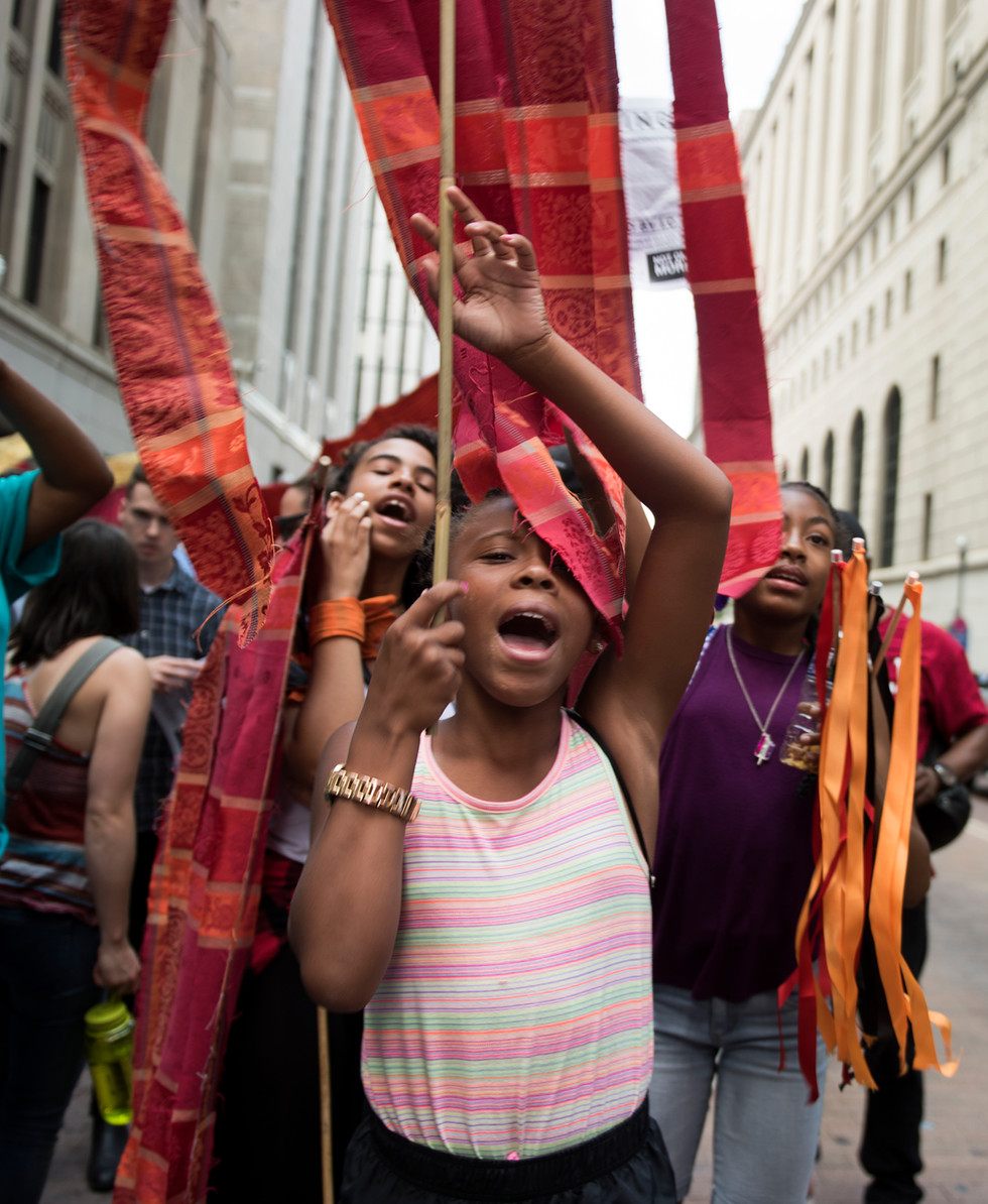 Aniyah Grayson from the Jeron X. Grayson Community Center leads her friends in a chant during the Still We Rise March, part of the People's Convention, downtown on July 8, 2016. (Pittsburgh Post-Gazette)