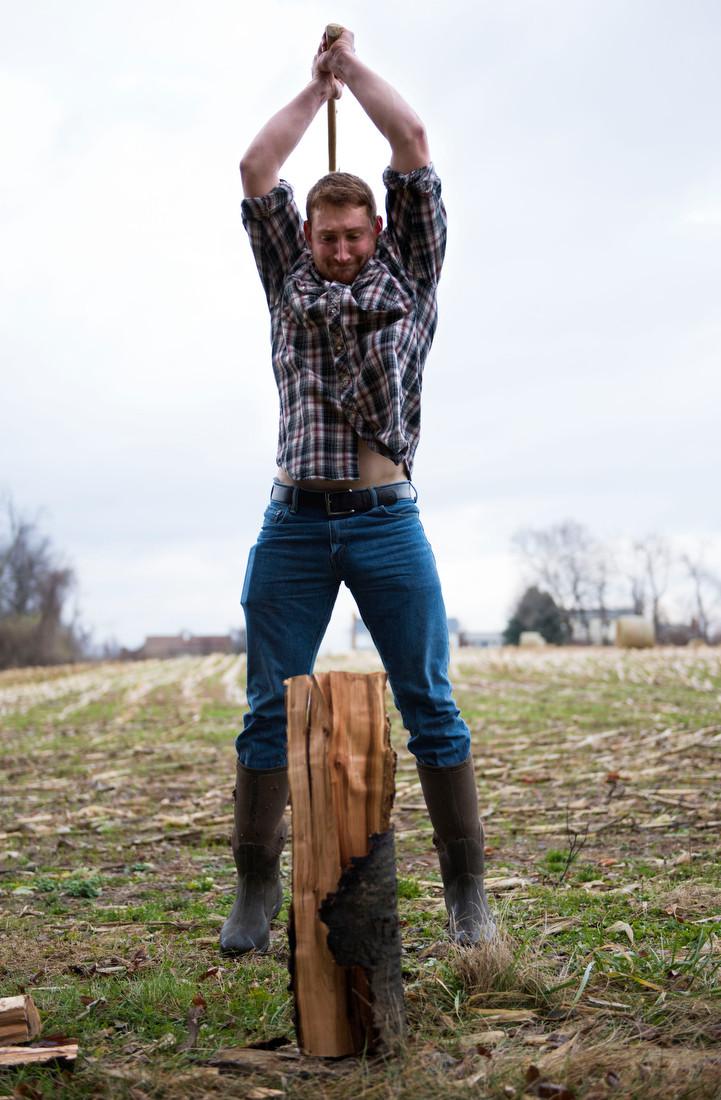 Zack Troyer chops firewood on Meyer Dairy Farm.
