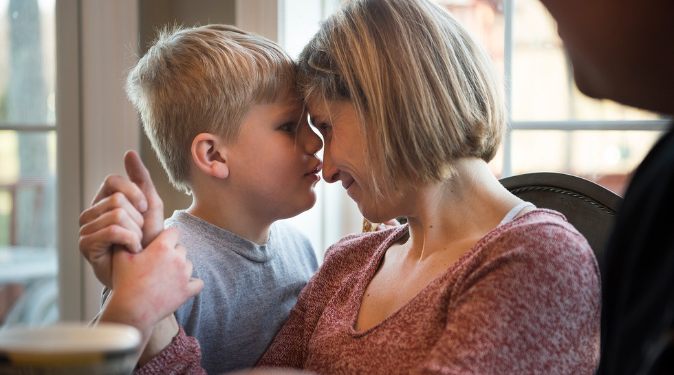 Layton Covol leans in to give his mother, Jamie Barbarich, a peanut buttery kiss to apologize for being rowdy at dinner time. His loud behavior worsens Barbarich's headaches caused by a brain tumor she has been battling for almost 10 years.
