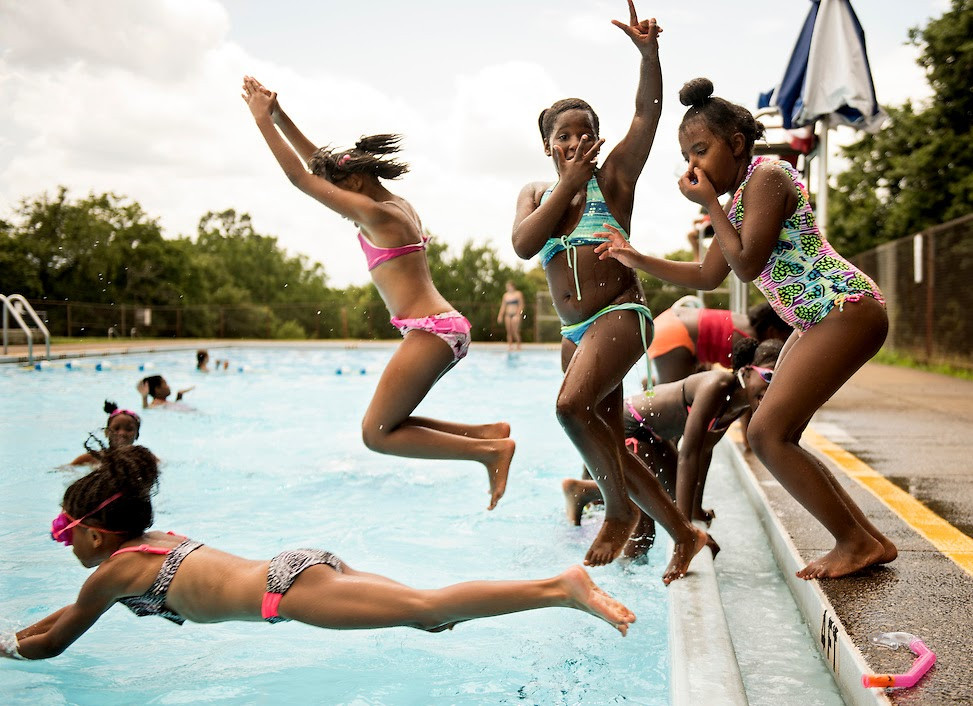 Campers from Gwen's Girls Summer Camp jump into Riverview Pool in Observatory Hill on August 10, 2016. (Pittsburgh Post-Gazette)