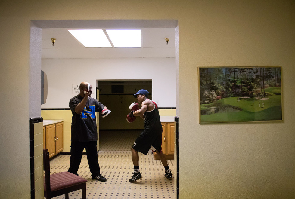 Johnny Spell Sr. coaches his son, Johnny Spell III, through warm ups in the locker room before his fight at the Western Pennsylvania Golden Gloves Championships on April 1, 2017 at the 3 Lakes Golf Course in Penn Hills. (Pittsburgh Post-Gazette)
