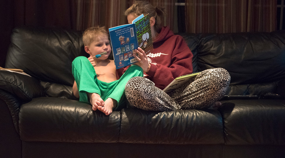 Jamie Barbarich reads a bedtime story to her son, Layton Covol.
