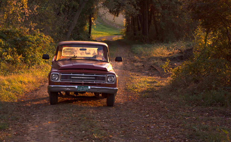 Zack Troyer drives his 1968 International truck back to his campsite on Meyer Dairy Farm in State College, Pa.
