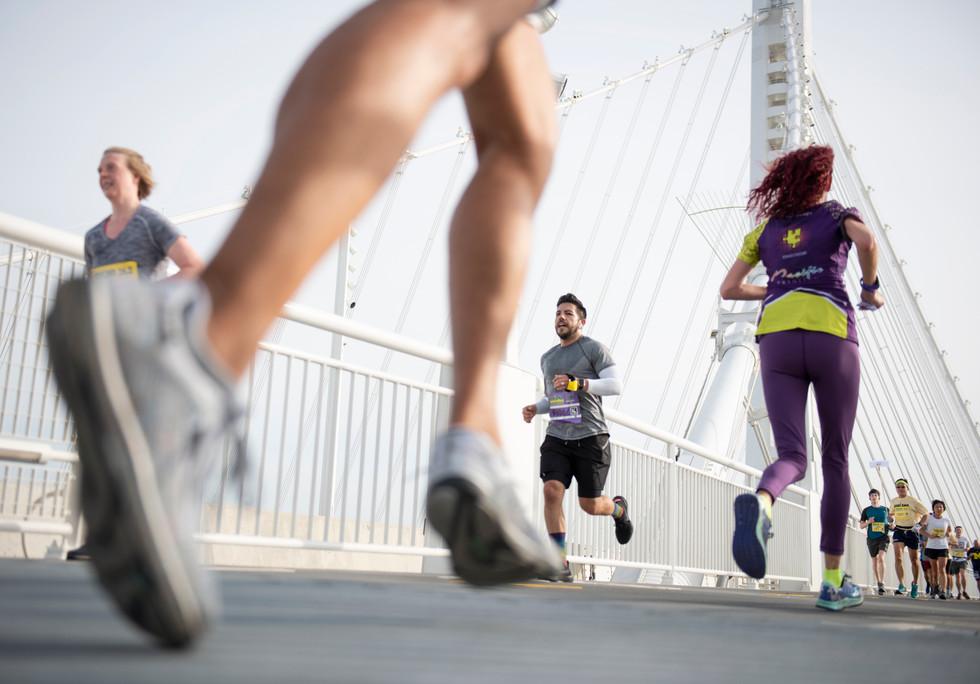 Marathon competitors run across the Bay Bridge at the Oakland Marathon on March 24, 2019 in Oakland, California. (Bay Area News Group)