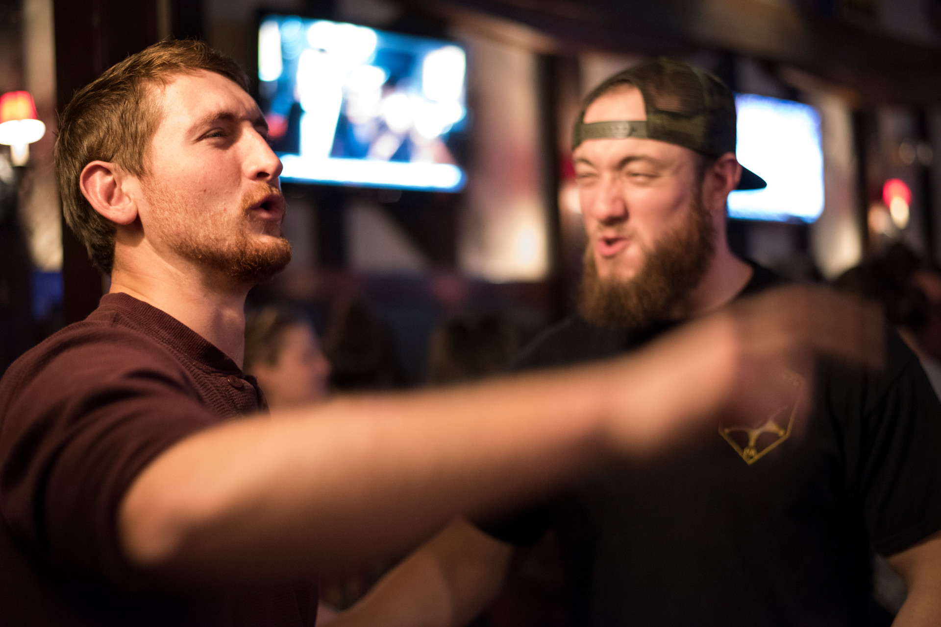 Troyer and his friend, Paul Kemper, sing along to the music at Pickles' country night. Troyer attended country night every Tuesday with his friends.