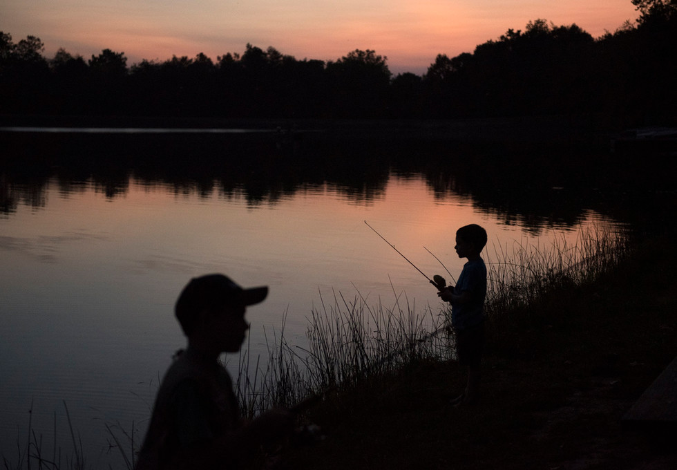 Noah Snyder, 5, from Monroeville, right, and his brother, Bryce, 8, fish at dusk on Thursday, Sept 21, 2017 at Keystone State Park in Derry Township. (Pittsburgh Post-Gazette)