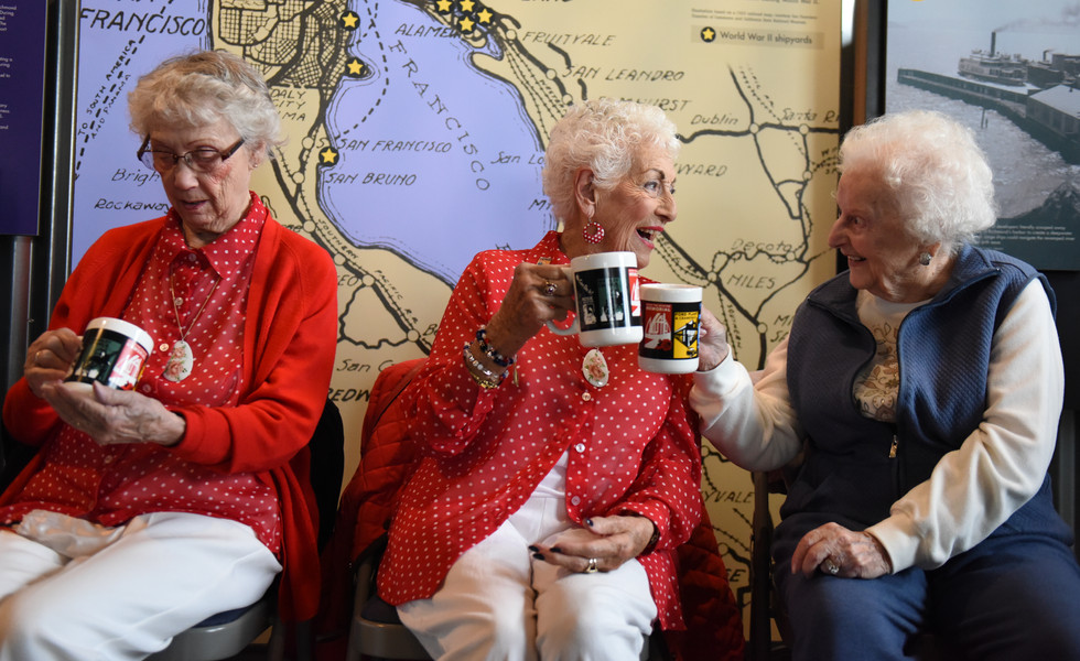 Marian Sousa, 92, left, inspects her newly gifted mug as Kay Morrison, 94, and Josephine Lico, 103, say cheers at the National Rosie the Riveter Day Celebration on March 21, 2018 at the Rosie the Riveter Visitor Education Center in Richmond, California. (Bay Area News Group)