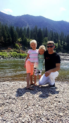 Drew Homola and daughters at a mountain lake