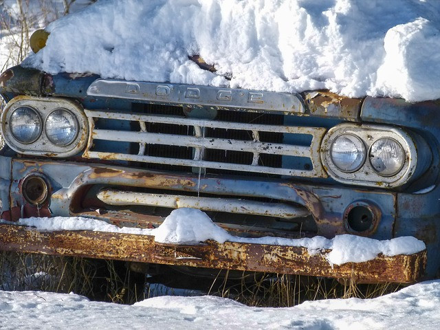snow-covered old dodge car