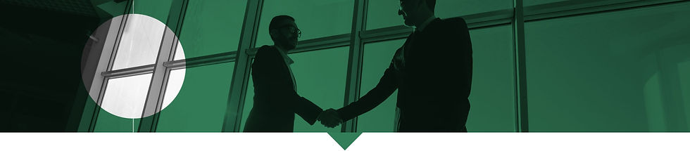 Silhouette of two man shacking hands in front of a large window.