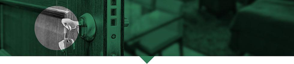 Door ajar with key in lock.
