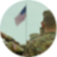 Army personnel saluting the US flag