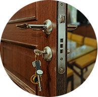 Door ajar with key in lock